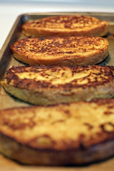 Hosting brunch or breakfast this weekend? Knock your guests' socks off with this Yogurt French Toast recipe, which has ALL of the flavor and less fat than the regular. Crusty pieces of bread are dipped in a yogurt, skim milk and egg mixture before frying in a pan with a little butter until golden brown. The French Toast pieces are then baked until cooked through. Enjoy warm with fresh berries and your favorite syrup!