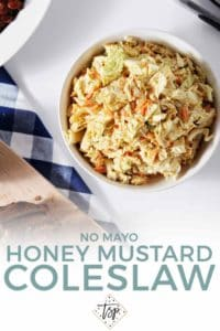 Pinterest graphic for No Mayo Honey Mustard Coleslaw, featuring an overhead image of the slaw with other barbecue sides.