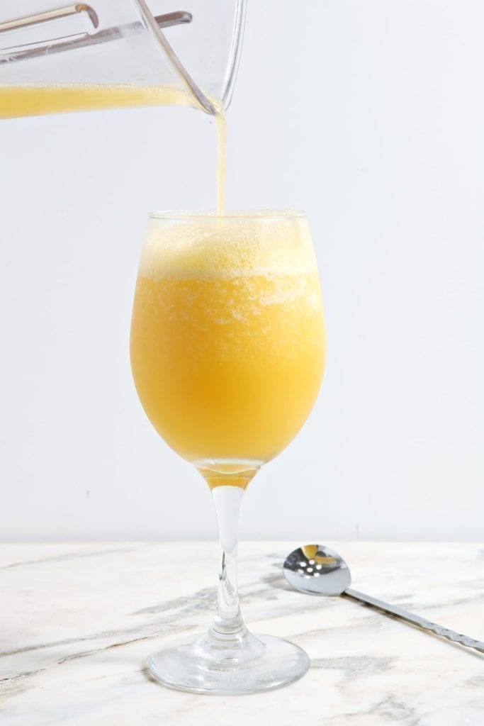 Who doesn't love a mimosa on a gameday morning? Step up your brunch drink game this season by making these deliciously chilled Blended Mimosas! #mimosa #drink #cocktail #tailgate