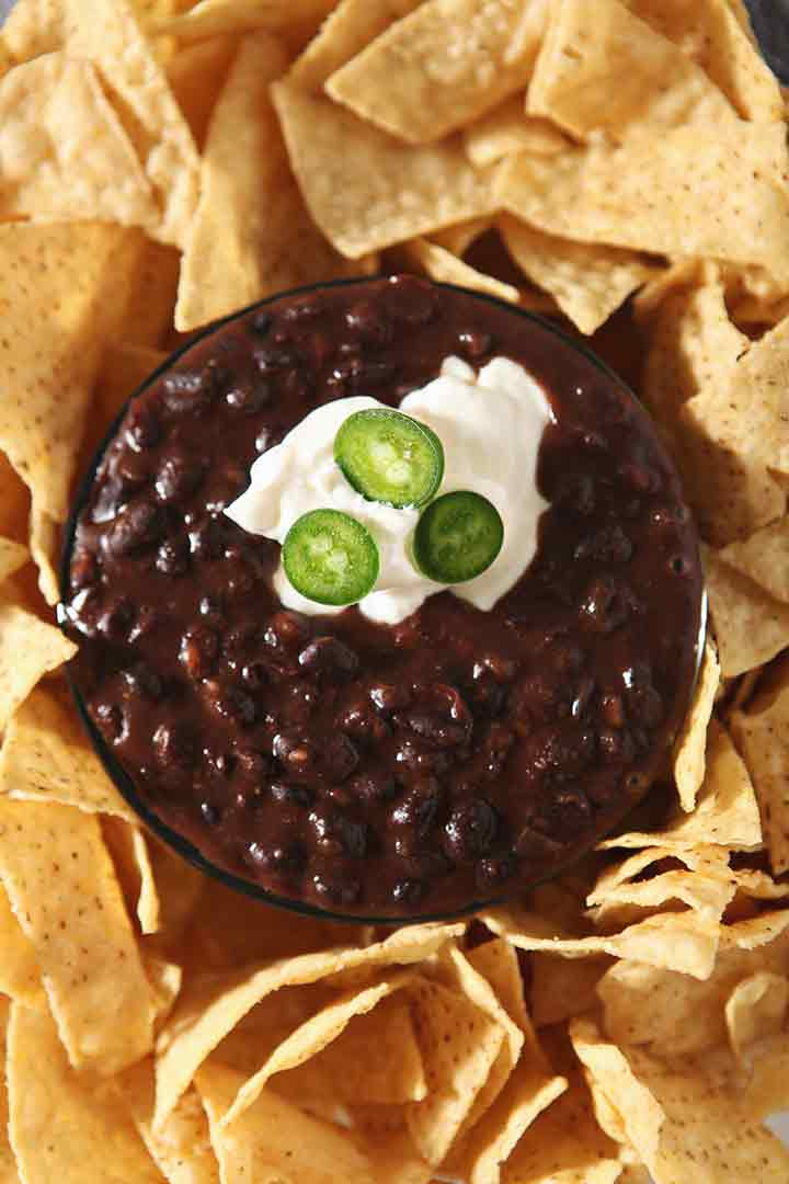 Close up of Black Bean Dip, garnished and ready for dipping