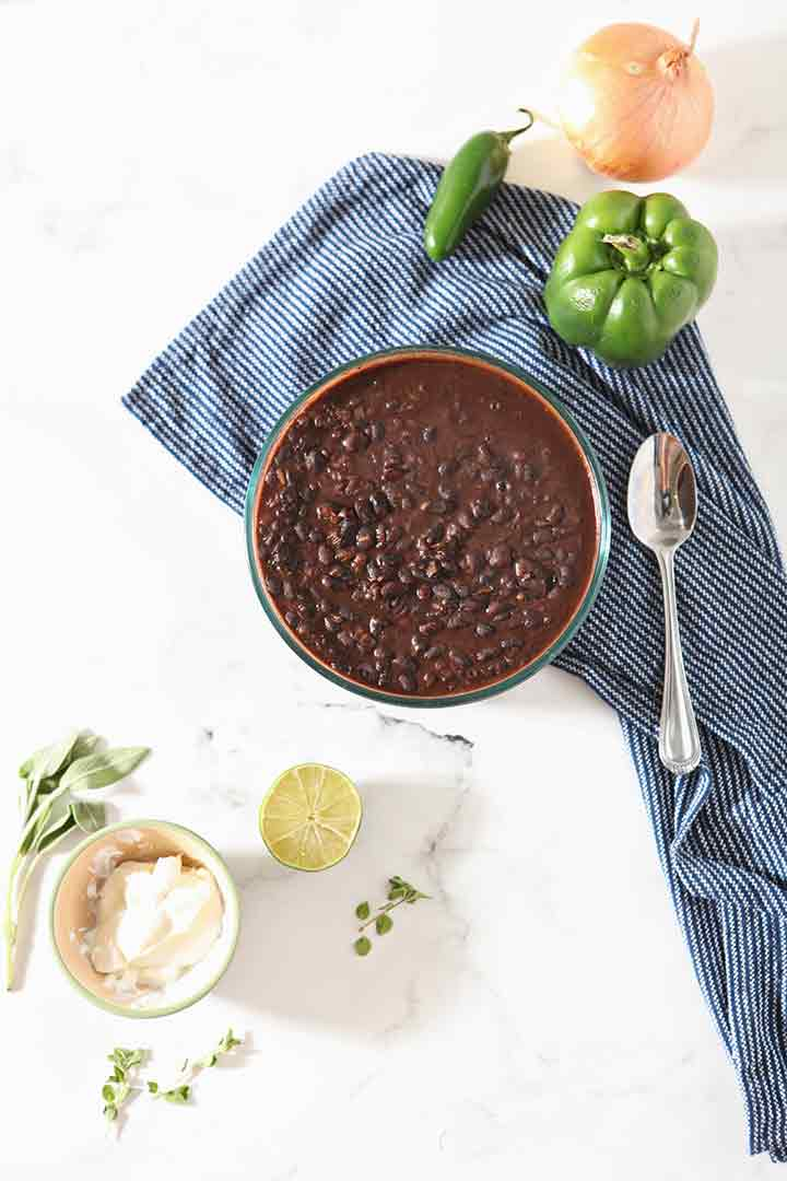 The cooked Black Bean Dip, shown with other ingredients and garnishes, before serving