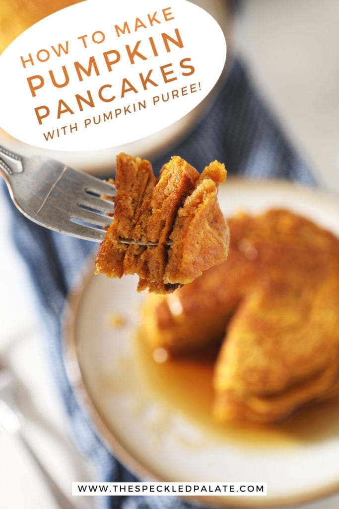 A fork holds a triangular bite of pancakes with a white plate of pancakes behind it with the text 'how to make pumpkin pancakes with pumpkin puree'