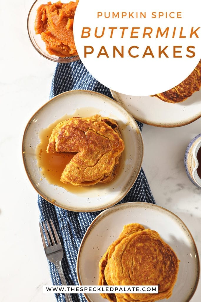 Three plates of orange pancakes with syrup and a bowl of pumpkin puree with the text 'pumpkin spice buttermilk pancakes'