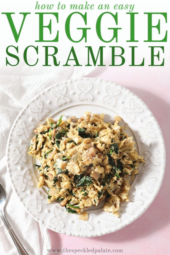 A white plate holds a large serving of Scrambled Eggs with Spinach, mushrooms and onions with the text 'how to make an easy veggie scramble'
