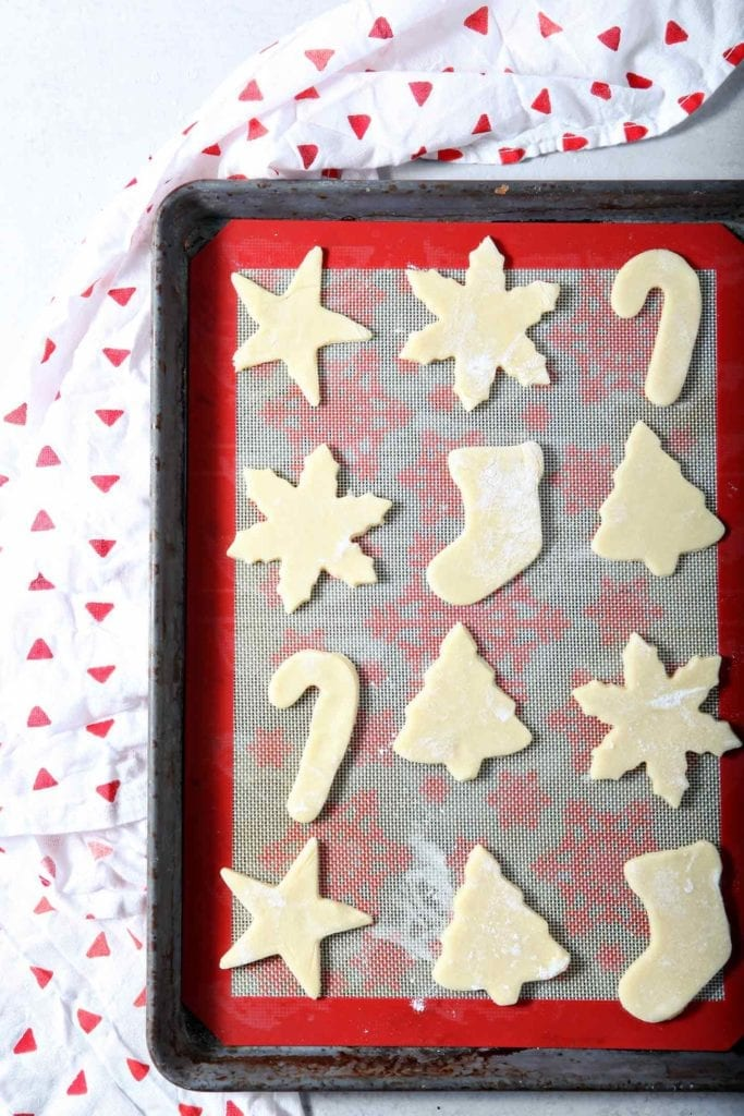 Cut out All-Butter Tea Cake Cookie Dough sits on a baking sheet before going into the oven