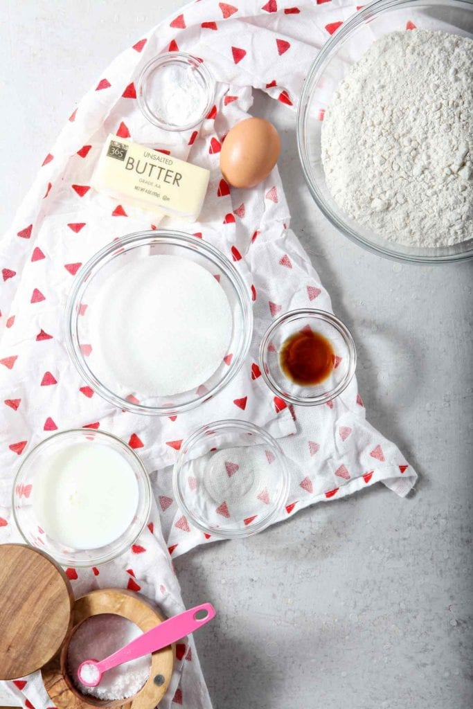 Ingredients for All-Butter Tea Cake Cookies are laid out on a grey backdrop, ready for mixing