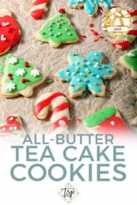 Pinterest image for All-Butter Tea Cake Cookies, featuring text and a close up of the final decorated cookies drying