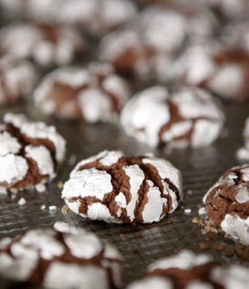 Chocolate Crinkles on a baking sheet after coming out of the oven
