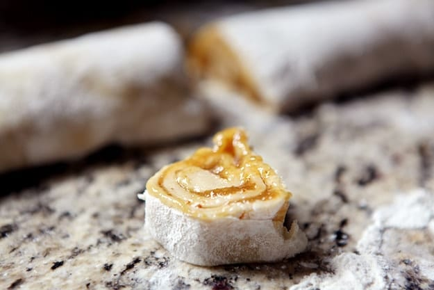Close up of Fig Pinwheel cookie on a granite countertop