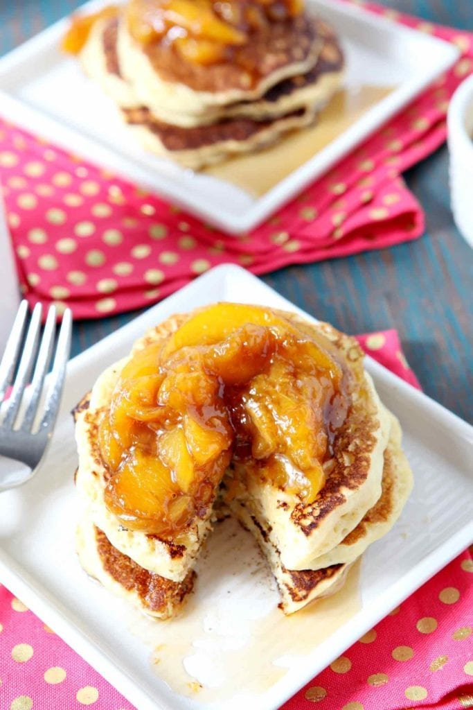 Close up of peach compote on a stack of pancakes, cut into