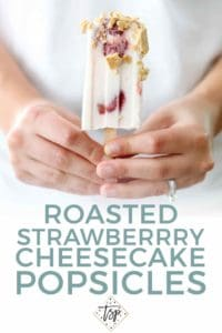 Pinterest graphic for Roasted Strawberry Cheesecake Pops, featuring a woman holding one of the popsicles in hand
