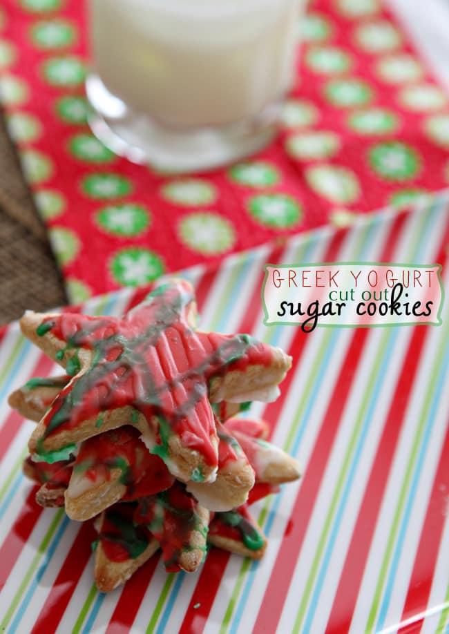 A stack of star-shaped Greek Yogurt Cut Out Sugar Cookies on a colorful Christmas striped platter