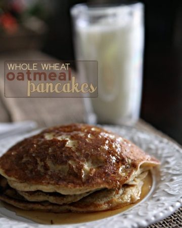 A stack of Whole Wheat Oatmeal Pancakes with syrup on a white plate