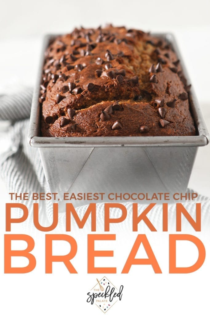 Close up of a loaf of pumpkin bread in a metal pan topped with chocolate chips with the text 'the best, easiest chocolate chip pumpkin bread'