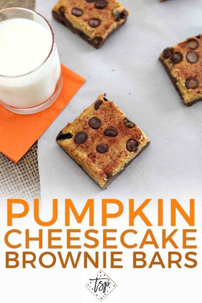 Overhead of pumpkin cheesecake bars on a white piece of parchment with a glass of milk and the text 'pumpkin cheesecake brownie bars'