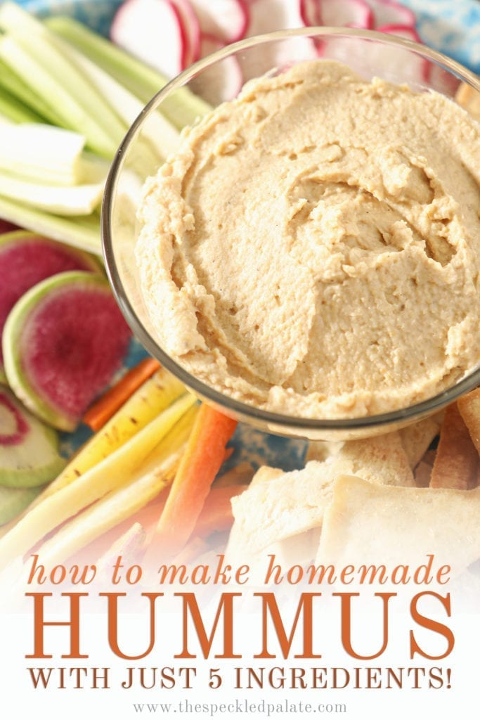 """Close up of hummus dip in a clear glass bowl surrounded by veggie slices with the text """"how to make homemade hummus with just 5 ingredients"""""""