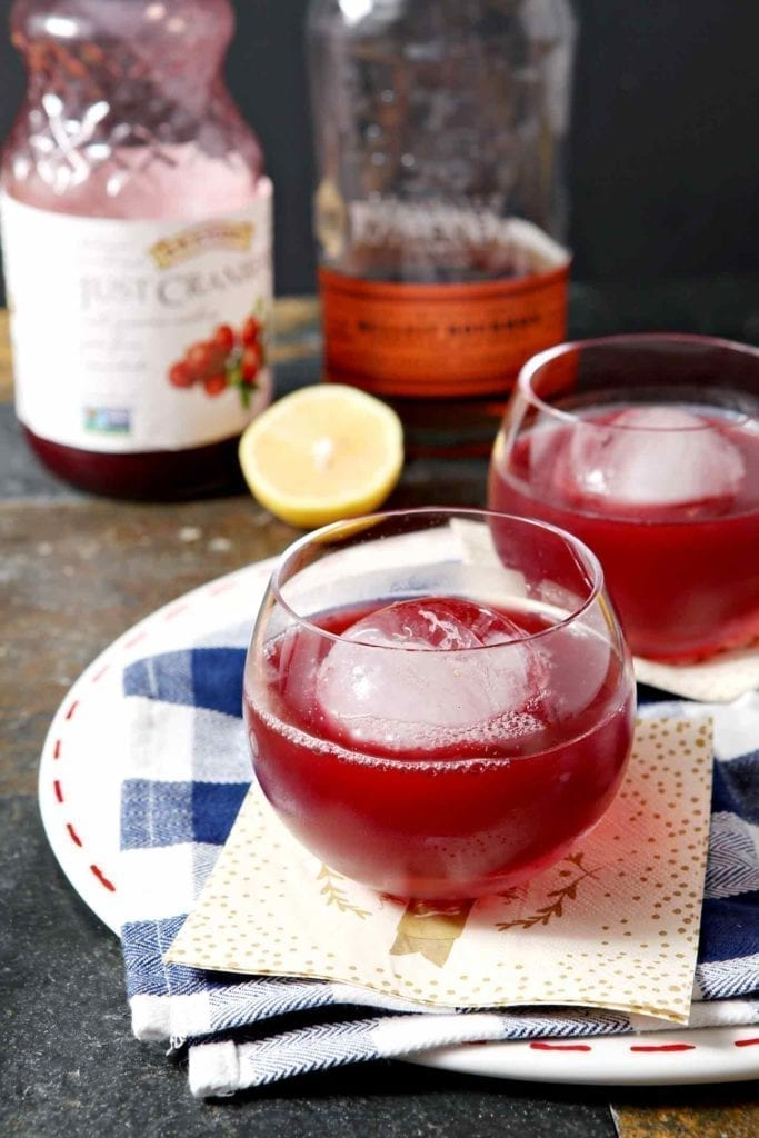 Looking for a unique bourbon drink to enjoy during Thanksgiving, Christmas and other winter holidays? 100% pure cranberry juice mixes with bourbon, freshly squeezed lemon juice and homemade simple syrup to create this winter-flavored cocktail, entitled The Blizzard. Serve with frozen cranberries or ice, and enjoy this slightly sweet bourbon drink during the chilly months.