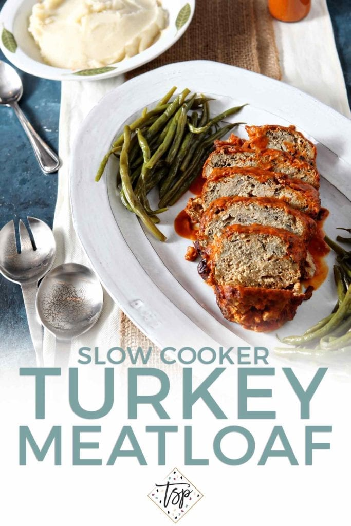 Pinterest graphic for Slow Cooker Turkey Meatloaf, featuring text and an overhead image of the sliced meatloaf covered in tomato sauce