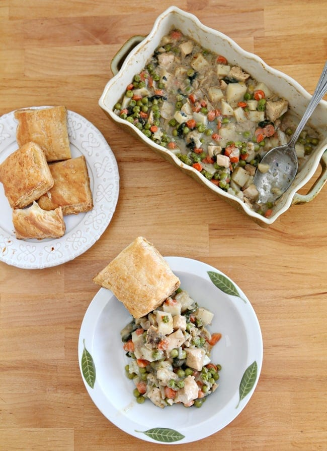 Homemade Chicken Pot Pie is the ultimate comfort dish and is so easy to make! This recipe is chock full of chicken and vegetables, then topped with individually baked pieces of Puff Pastry so the crust is never soggy.