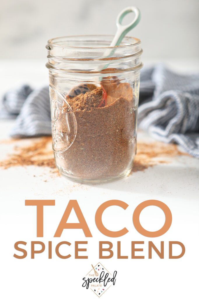 A mason jar of homemade seasoning with the text taco spice blend
