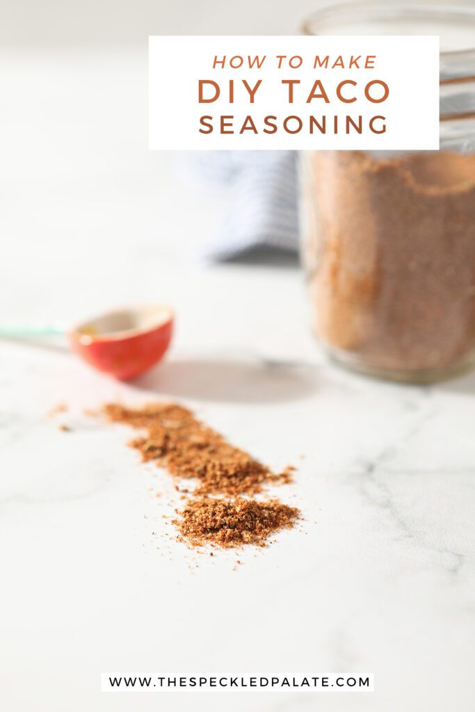 A seasoning mix on marble with the text how to make DIY taco seasoning