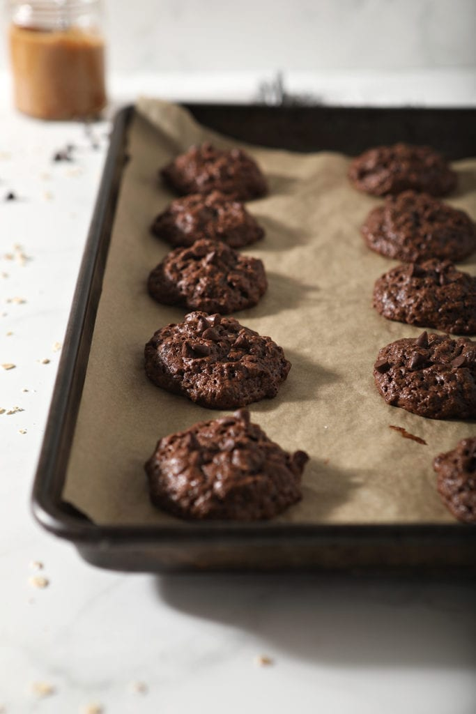 Chocolate Almond Butter Cookies with Chocolate Chips on a baking pan after baking