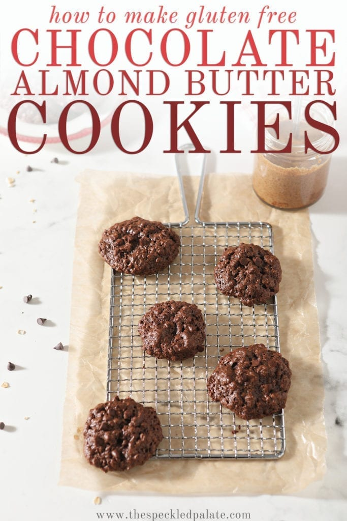 A few Gluten Free Chocolate Cookies sit on a metal grate on top of parchment paper with the text 'how to make gluten free chocolate almond butter cookies'