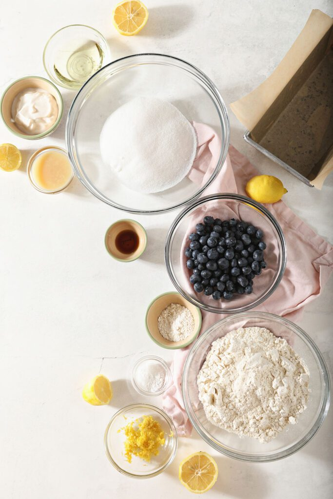 Ingredients for Lemon Blueberry Quick Bread recipe in bowls on marble