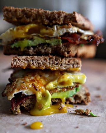 Close up of stacked bacon, avocado and egg sandwich