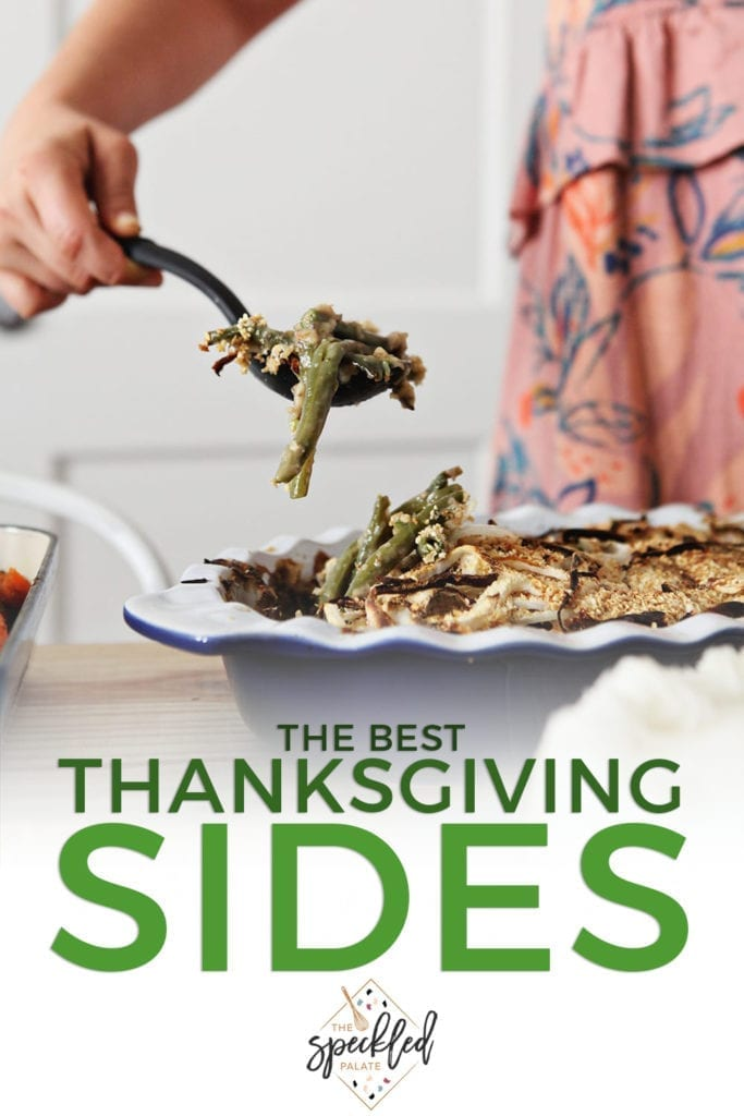 A woman in a pink dress lifts a scoop of green bean casserole out of a blue dish with the text 'the best thanksgiving sides'