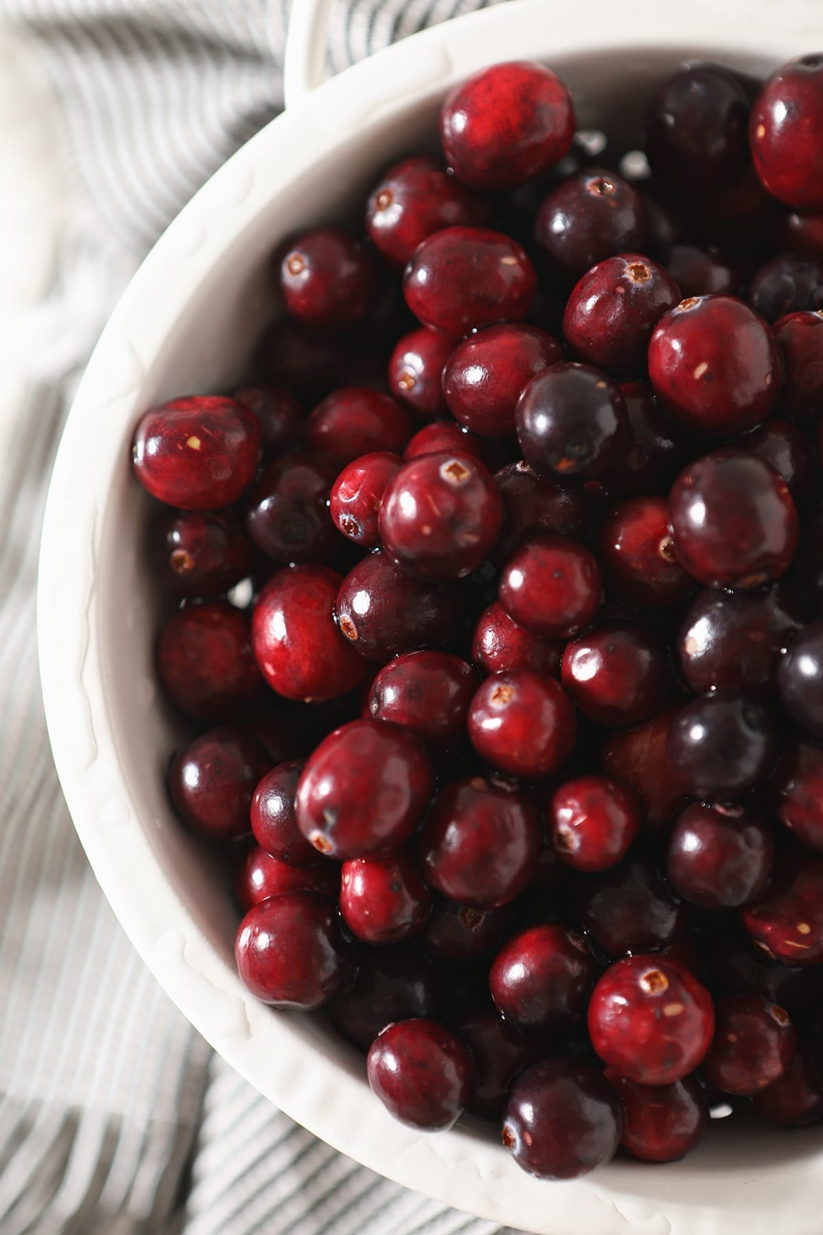 Close up of cranberries in a white colander