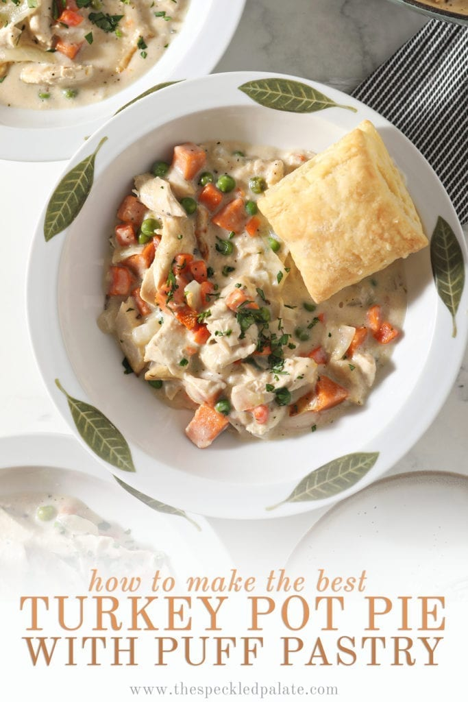 Close up of a decorative bowl holding a serving of Turkey Pot Pie topped with a golden puff pastry square with the text 'how to make the best turkey pot pie with puff pastry'