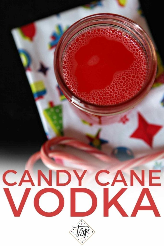 Pinterest image for Candy Cane Vodka, showing the mason jar from above after the infusion