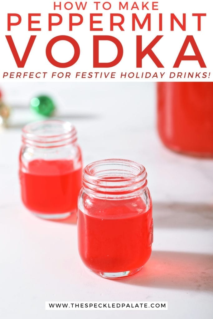 Two shot glasses of peppermint vodka on a marble surface next to a mason jar full of the candy cane-infused vodka with the text 'how to make peppermint vodka. perfect for festive holiday drinks!'