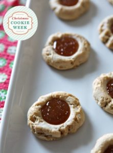 Dairy-Free Salted Caramel Thumbprint Cookies are a delightful Christmas cookie loved by the whole family. Slightly sweet sugar cookie dough is baked in rounds before being filled with homemade dairy-free caramel. Finish the cookies with a sprinkle of sea salt, and enjoy warm!
