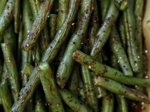 Roasted Green Beans are simple and utterly delicious! Toss fresh green beans in a mixture of balsamic vinegar, mustard, extra virgin olive oil, Sraracha sauce, black pepper and sea salt then roasted to create a slightly sweet and spicy side dish for the holiday table.