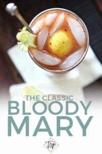 Pinterest image of Bloody Mary, featuring an overhead close up of the drink and text.