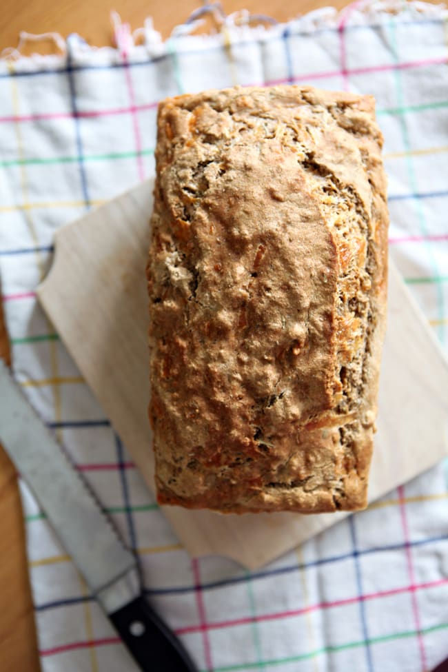 Cheddar and Herb Beer Bread is simple and delicious to make as an accompaniment for any meal. Combine the ingredients, then 60 minutes later, you have a beautiful loaf of freshly baked bread!
