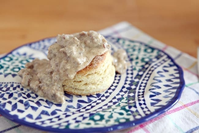 Southern-Style Biscuits and Gravy are the ULTIMATE Southern comfort breakfast! Fluffy, buttery biscuits are topped with a creamy white sausage gravy and make a perfect weekend meal.