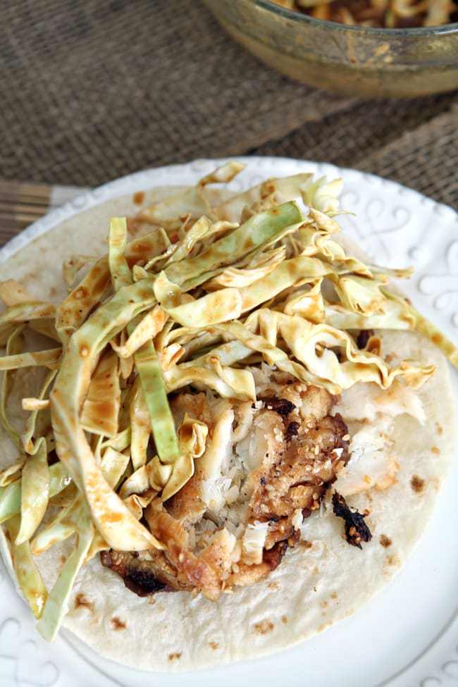 Soy Seared Cod Tacos with Spicy Slaw are delicious for runners and non-runners alike! Wild-caught cod is seared with olive oil and soy sauce, then topped with a spicy Asian-inspired cabbage slaw.