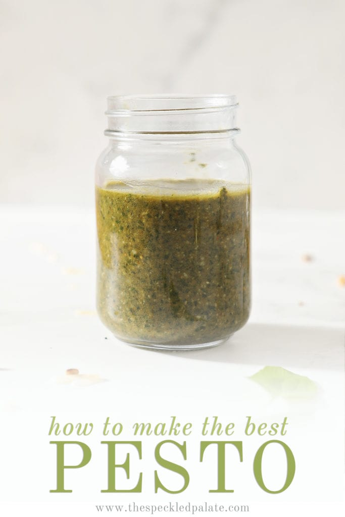 A jar of homemade pesto on marble with the text how to make the best pesto