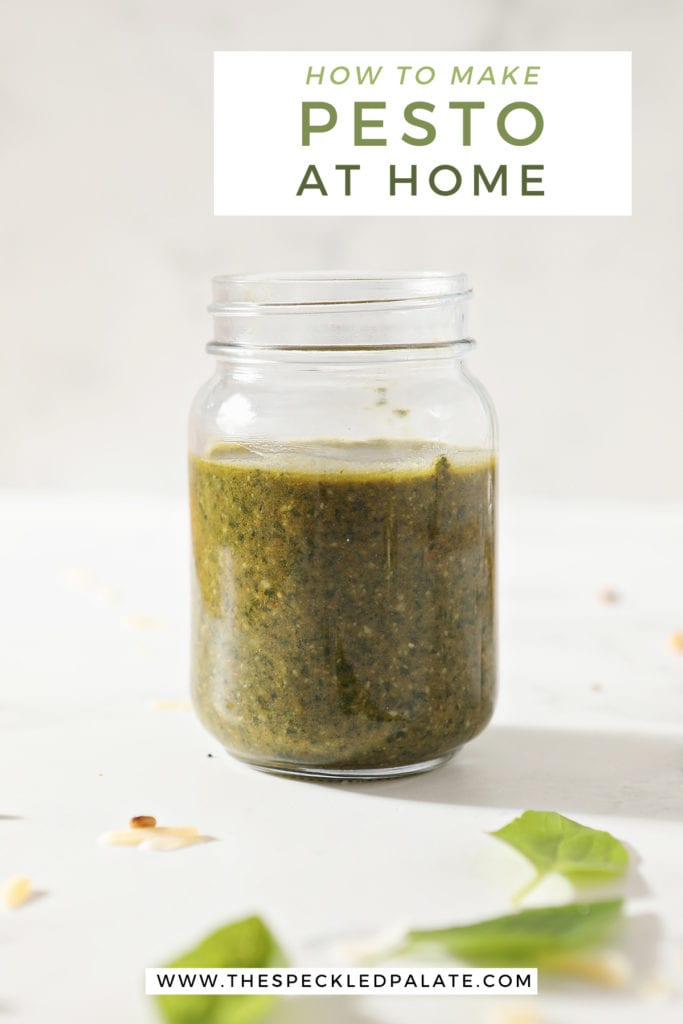 A jar of homemade pesto on marble with the text how to make pesto at home