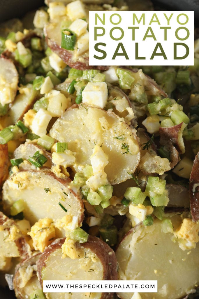 Potatoes with eggs, celery and dill in a bowl with the text no mayo potato salad