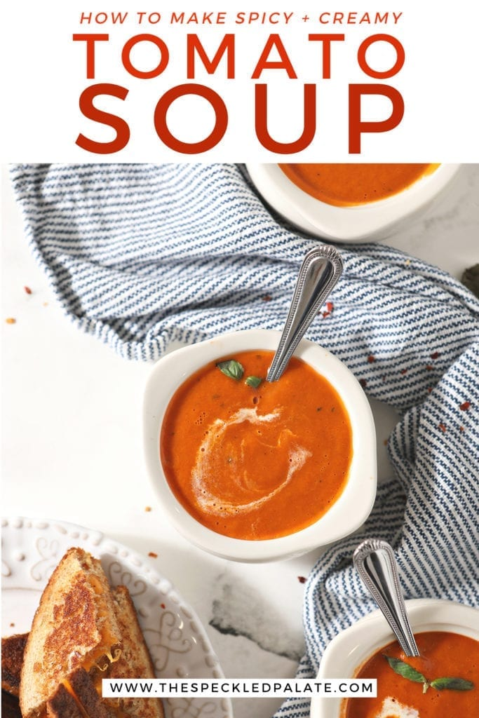 Three bowls of tomato soup sit on a blue striped towel with the text 'how to make spicy + creamy tomato soup'