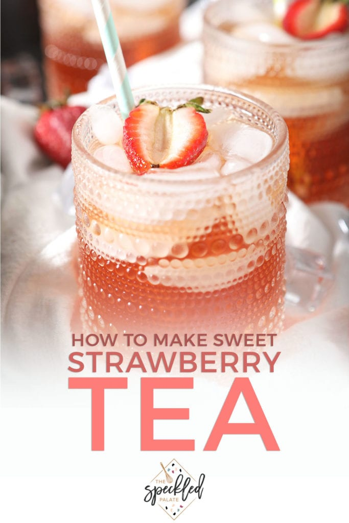 A glass of pink tea with a strawberry with the text how to make sweet strawberry tea