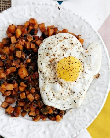 Diced sweet potatoes are cooked with roasted poblanos, red onion, garlic and rosemary, then topped with a fried egg. These Sweet Potato Hash with Fried Egg are well-loved and perfect for any athlete (or non-athlete!) in your life!
