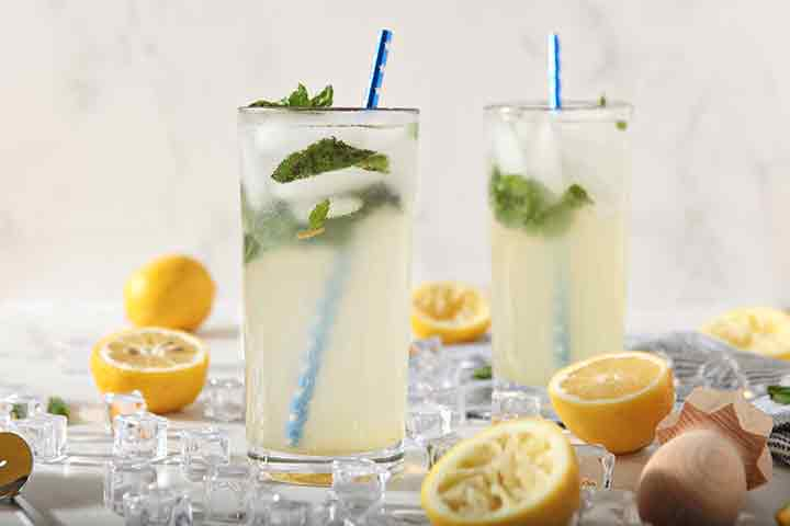 Horizontal image showing a close up of two glasses of Mint Lemonade