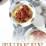 Overhead of three bowls of Turkey Pasta Sauce, with Pinterest text