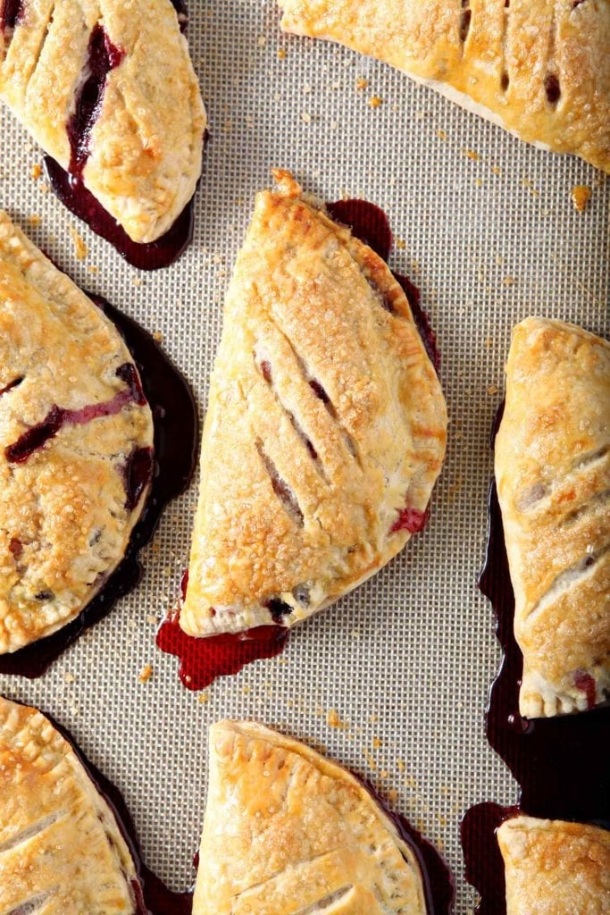 Close up of baked hand pies on a nonstick baking mat