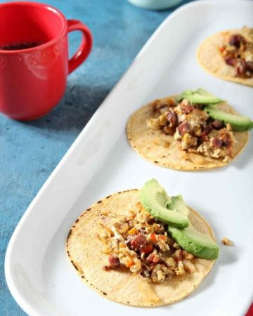 breakfast tacos on a white serving tray